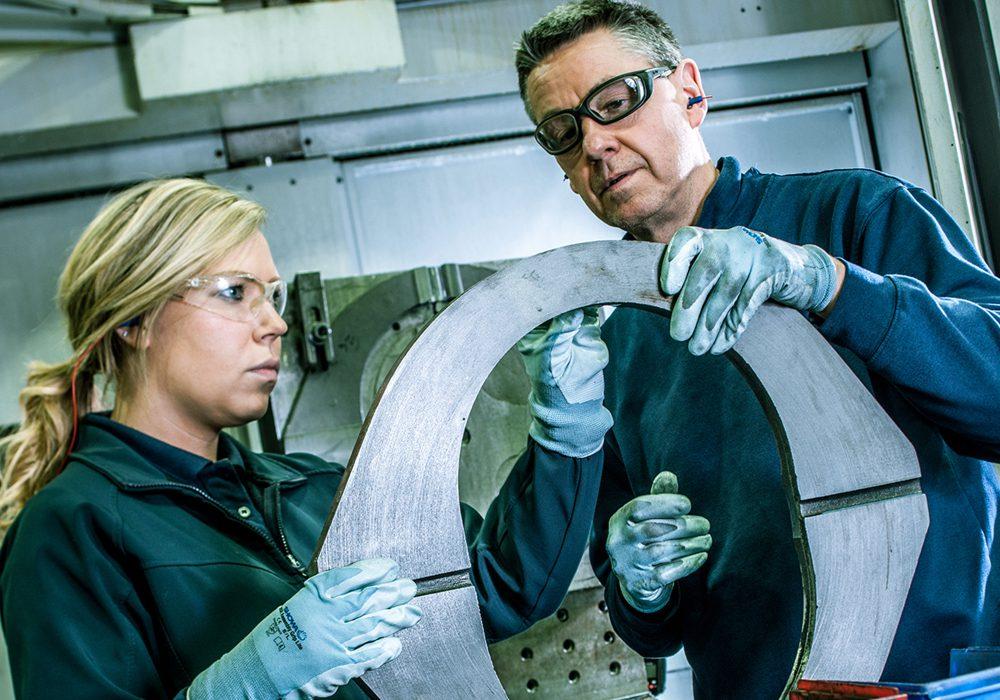 British Engines factory workers inspecting metal work